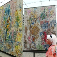 Part of Marc Chagall's mosaic mural, which our guide (pictured) took us to see.