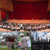 The orchestra playing the Grant Park Music Festival at the Jay Pritzker Pavilion.