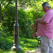 A musician entertaining in the zoo.