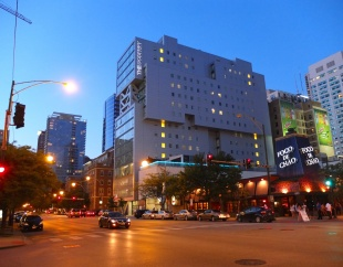 The exterior of The Godfrey Hotel at night.