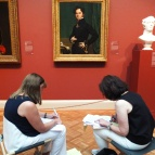 Ladies (guides, students, writers?) working on some sort of project in one of the galleries.