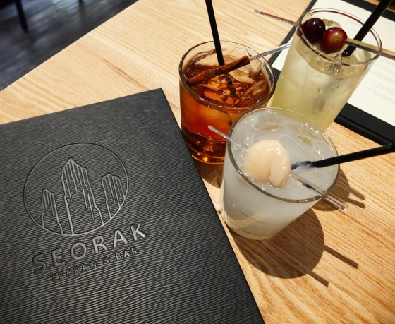The SEORAK logo along with a few of their signature cocktails.