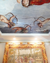 Part of one of the fresco ceilings and a decorative tapestry.