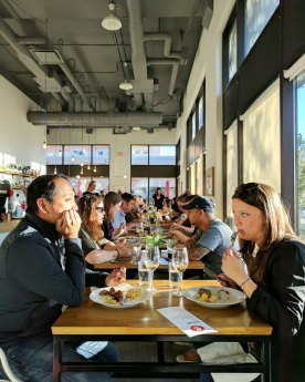 Diners enjoying their pop-up dinner at District Cafe.