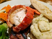 Buttered Lobster Tail on top of a 10 oz. New York Striploin
