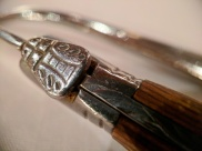 The handle of the steak knife. I love these Forge de Laguiole utensils.