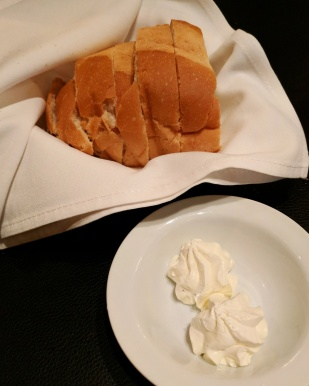 Complimentary sourdough bread with butter to start.