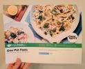 The front of the recipe card provides a photo, the cooking time and quick calorie info.
