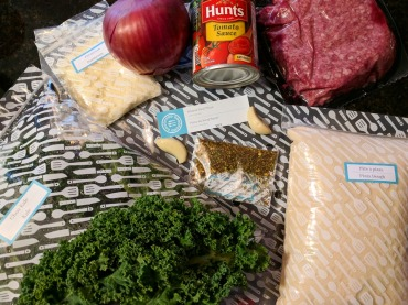 All of the Ground Beef Pizza ingredients laid out.