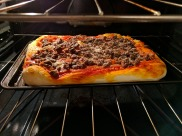 Our pizza baking in the oven.