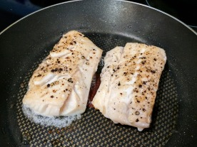 The fillets of Haddock cooking on the stove.