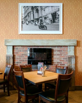 The central fireplace gives the place a homey feel.