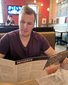 My fiancé perusing the drink menu.