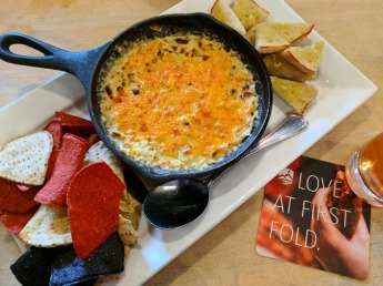 The Cauliflower Artichoke Dip comes in a hot skillet.