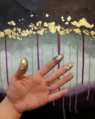 My hands covered in paint and foil.