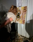 Natasha putting the finishing touches on her bee painting.
