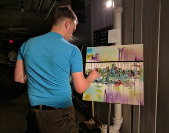 Reece Schulte working on his Edmonton skyline piece.