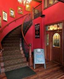 The foyer has a door to the right that leads into the Riverbank Bistro lounge.