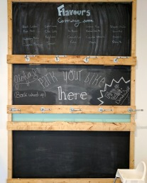 The chalkboard with upcoming specialty donut flavours and a built-in bike rack.