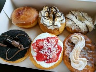 My box of a half-dozen doughnuts: Crème Brûlée, S'mores, Angel Flakes, Snickerdoodle, Strawberry Cheesecake and Oreo.