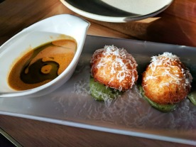 Arancini with red Thai coconut curry sauce