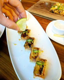Squeezing lime juice over the Seared Salmon Sushi for some zest.