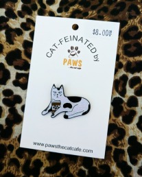 The cats eyes make me laugh on this pin from Paws the Cat Cafe.
